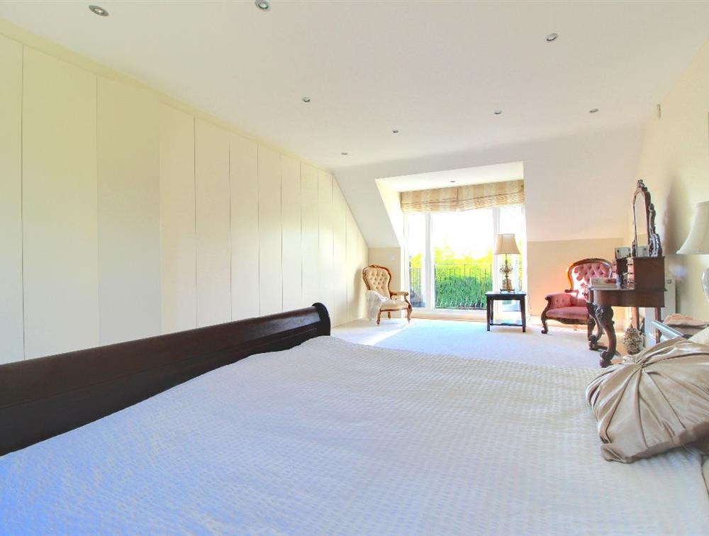 The Master Suite - where light enters the front window, and sun pours in from the balcony.  With a beautifully concealed en-suite bathroom, country views & floor-to-ceiling storage across the whole seven metres