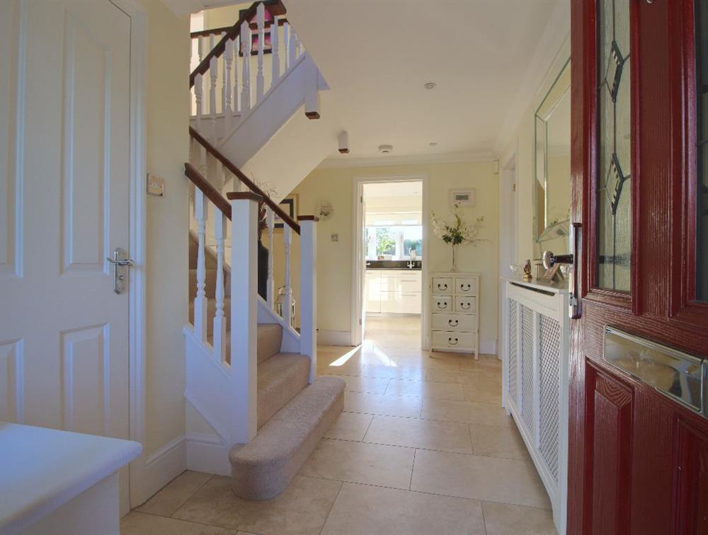 Travetine stone hallway welcomes you, with decadent underfloor heating