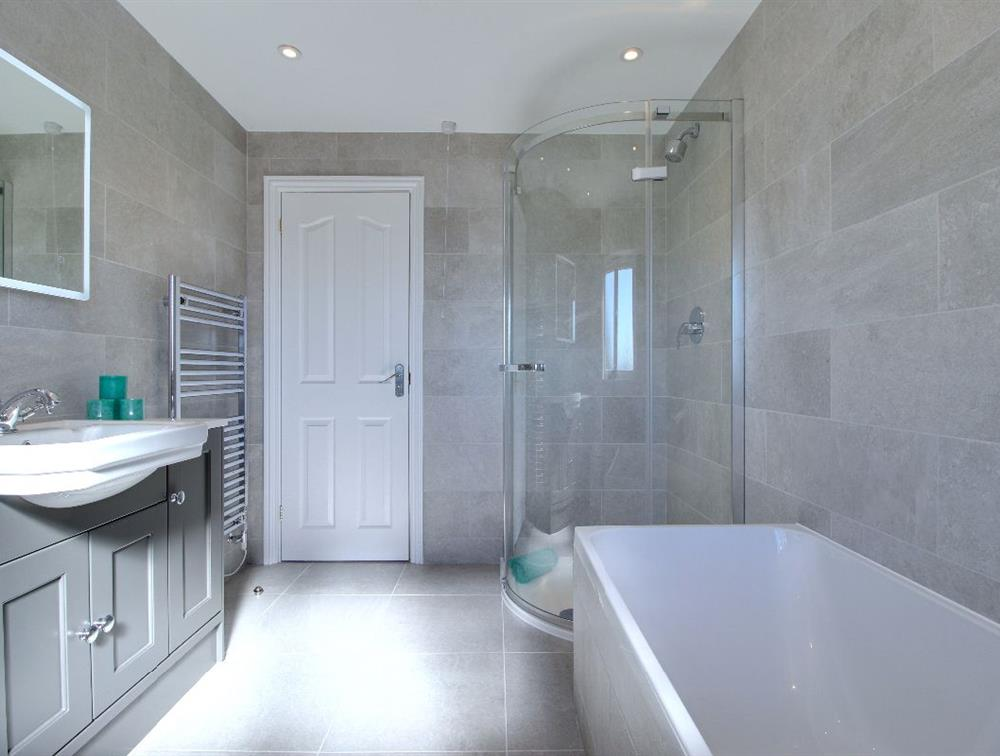 One of four bathrooms...  this, with luxury Merlyn corner glass enclosure & Gröhe shower fittings