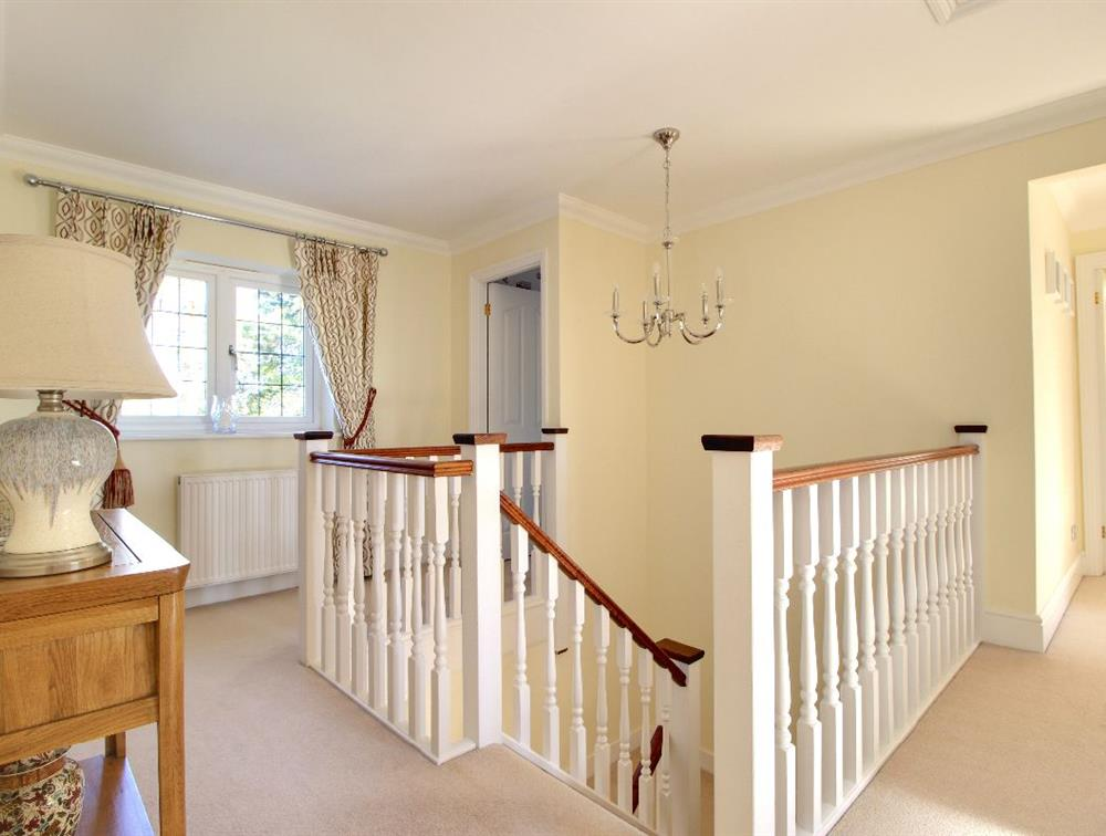 The central staircase leads to five bedrooms