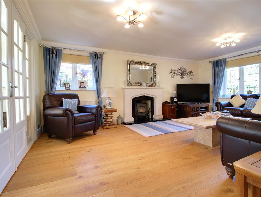 A quiet retreat, away from the hub of the family rooms.  Let yourself drift away with the wood-burning stove on quiet nights, or fling the double doors open to create a party space with the dining room and garden room